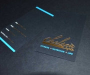 Business card, foil stamped in satin gold and light blue.