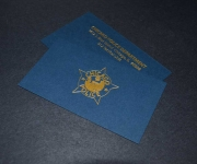 Business card, foil stamped in satin gold, for the Chicago Police 14th District Tactical Team.