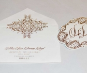 Reply envelope and monogram tag, foil stamped in rose gold.  The tag is die cut with a custom die.