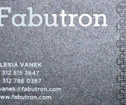 Business card, foil stamped in gloss black and white, on Stardream Onyx Cover stock.