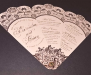 Fan style program.  Foil stamped in satin gold and rose gold foils, die cut and assembled with an eyelet.