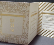 Trifold wedding save he date card. Foil stamped in satin gold foil.