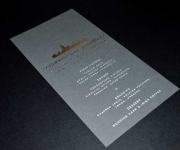 Menu, foil stamped with satin gold foil on gray cover stock.