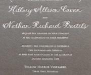 Wedding invitation, white foil on a gray paper.