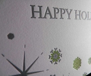 A close view of a two color letterpress printed Holiday card.