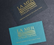 Business card.  Foil stamped in satin gold foil.  Two different paper colors are used, both of which are duplexed to become double thick.