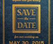 Save the date card.  Satn gold foil on midnight black cover stock.