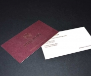 Business card.  Foil stamped on a Claret color cover, and letterpress printed on a Natural White color  cover.  Duplexed together after printing.