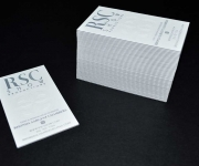 One color letterpress plus one blind letterpress, triplexed business cards. Two white sheets sandwiched with a center color sheet.