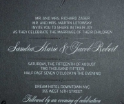 Wedding invitation.  Foil stamped in black and satin silver on midnight black cover stock.