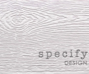 One color letterpress printed business card on a wood grained paper.