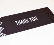 Thank you card.  Printed din gloss black and gloss white foil, onMidnight Black Cover stock.