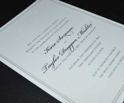 Wedding invitation in one color thermography and a blind emboss