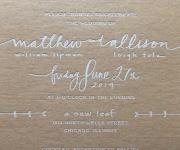 Wedding invitation in white foil, on tan chip board.